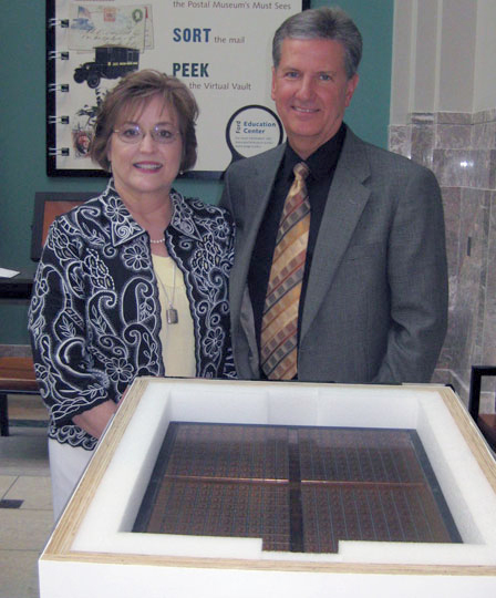 Vince and Becky King posed with the Lost Plate, still in its shipping container, on June 6, 2011