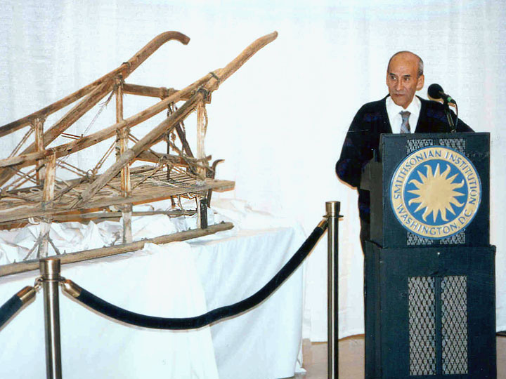 Charlie Biederman at the National Postal Museum in 1995, standing in front of the dog sled