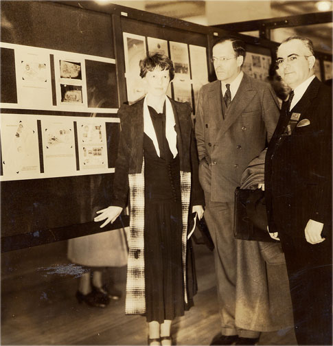 Earhart with husband George Putnam (center) and airmail specialist Nicolas Sanabria (right) at 1936 stamp exhibition