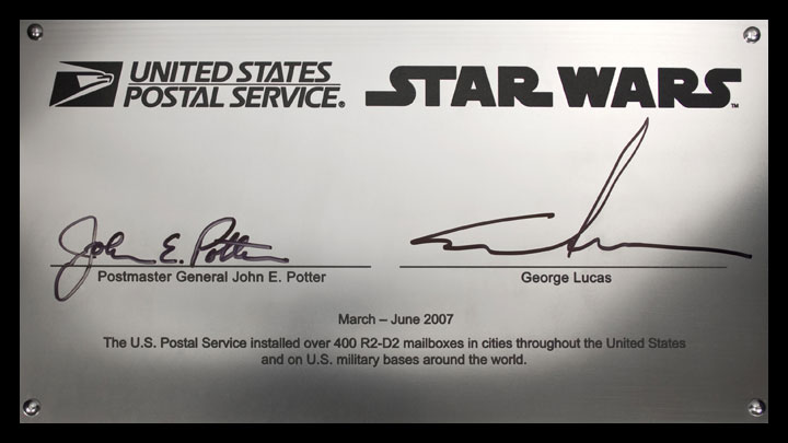 Star Wars R2-D2 mail collection box signature plate with the signatures of Postmaster General John E. Potter and George Lucas