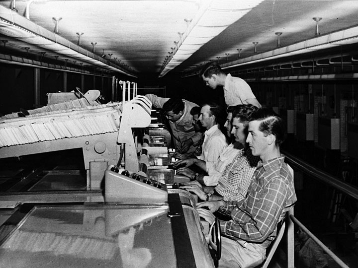 photo of men at mail sorting machines