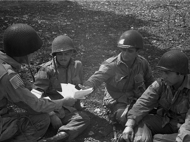three soldiers are given V-Mail blanks for their last letters before leaving England for the continent, June 6, 1944