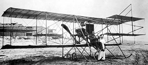 Wiseman Cooke Airplane, 1911, with a man and woman posing in front of it