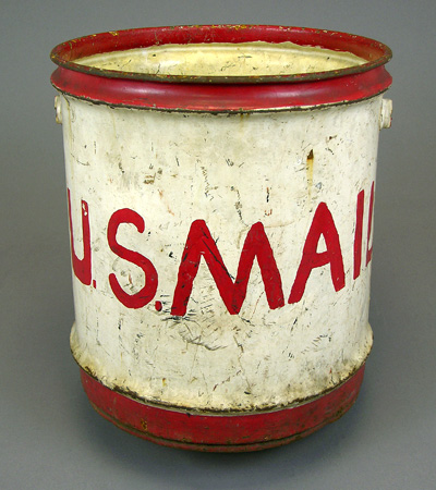 weathered five-gallon red and white steel mail pail