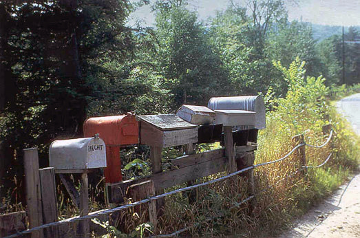 Mailboxes line a rural road
