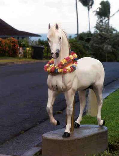 mailbox shaped like a white horse wearing a lei