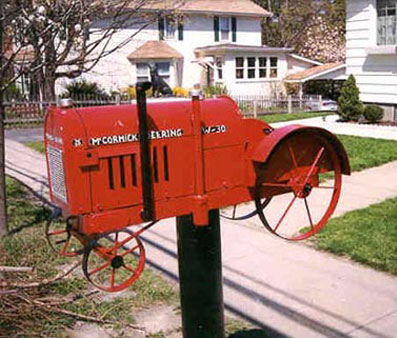 mailbox shaped like a red Deering tractor