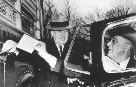 Roosevelt deposits a letter into a Highway Post Office Bus