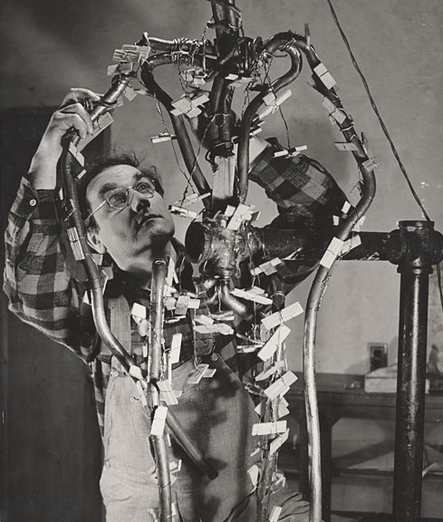 photo of William Zorach working on an armature (1940)