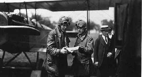 Major Reuben Fleet shows Lieutenant George Boyle a map of the flyway between Washington, D.C. and Philadelphia's Bustleton Airport