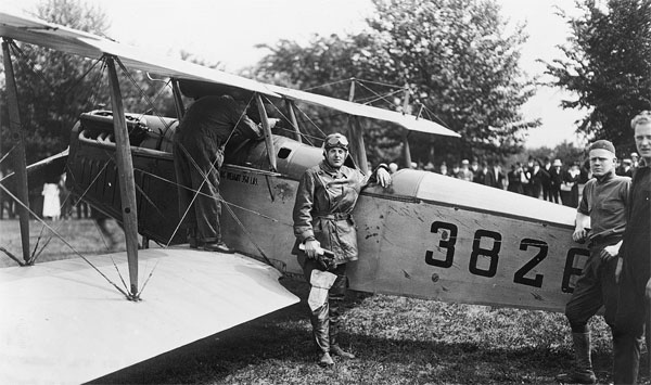 Major Reuben Fleet stands in front of a Curtiss Jenny JN-4B airplane