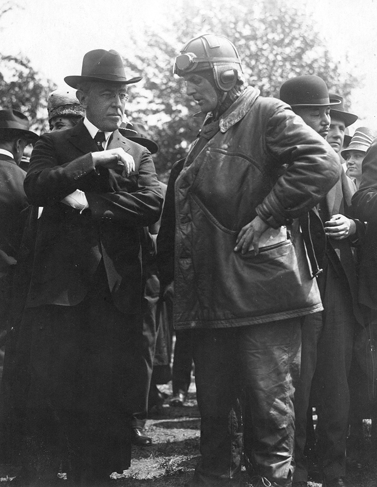 President Woodrow Wilson takes a moment to wish Army airmail pilot Major Reuben Fleet good luck