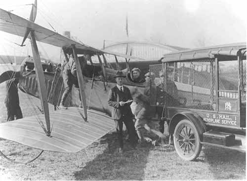 Two airmail pilots with a plane