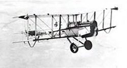 Old photograph of a biairplane in flight