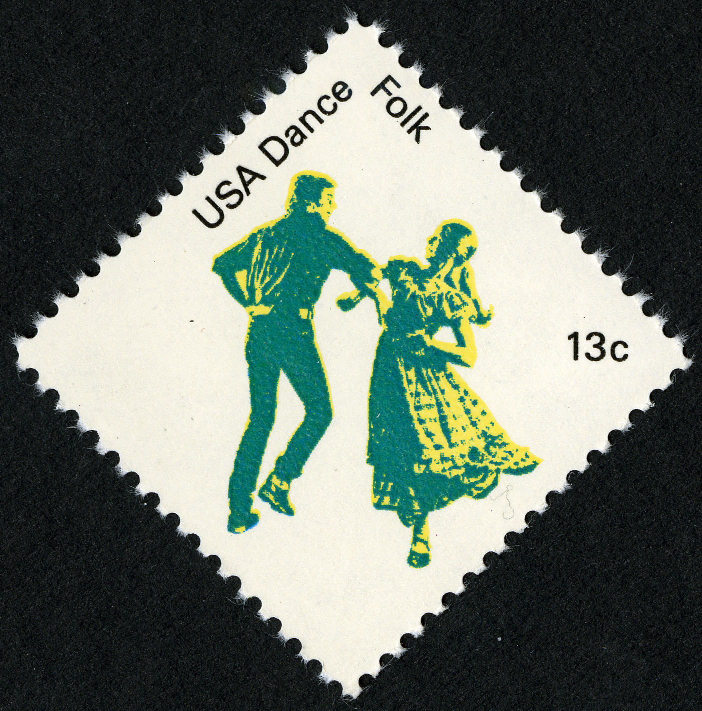Postage stamp with image of male and female interlinking arms, spinning in dance.