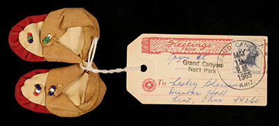 Small moccasins with an attached mailing label