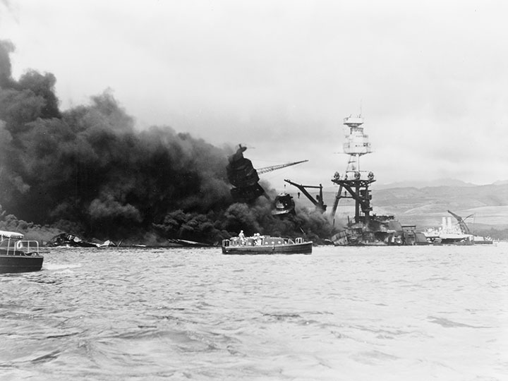 USS Arizona in flames following the Japanese air attack on Pearl Harbor, Hawaii, December 7, 1941.