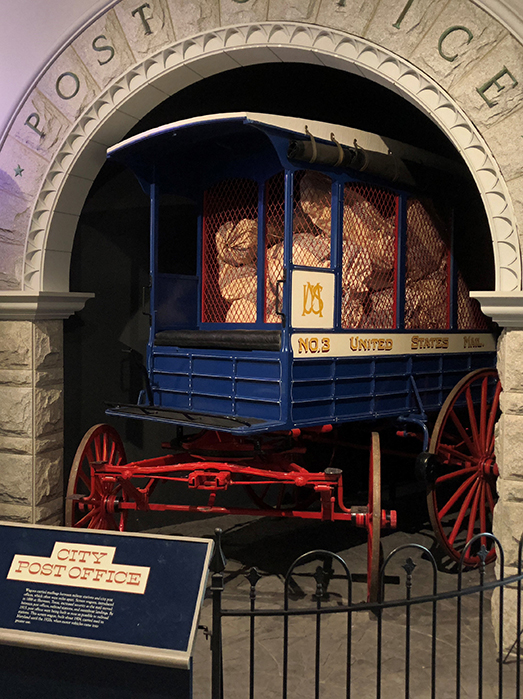 blue and red screen wagon on display in the museum