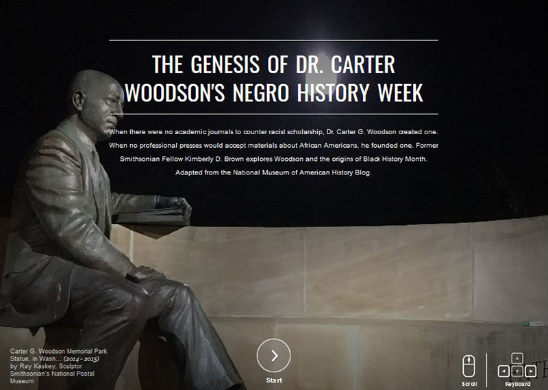 A statue of Carter Woodson sitting on a wall