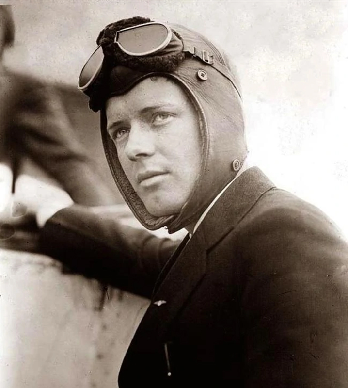 Pilot Charles Lindbergh posing for a photo wearing goggles and a helmet