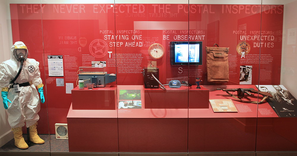 an exhibit case containing Postal Inspection Service related material