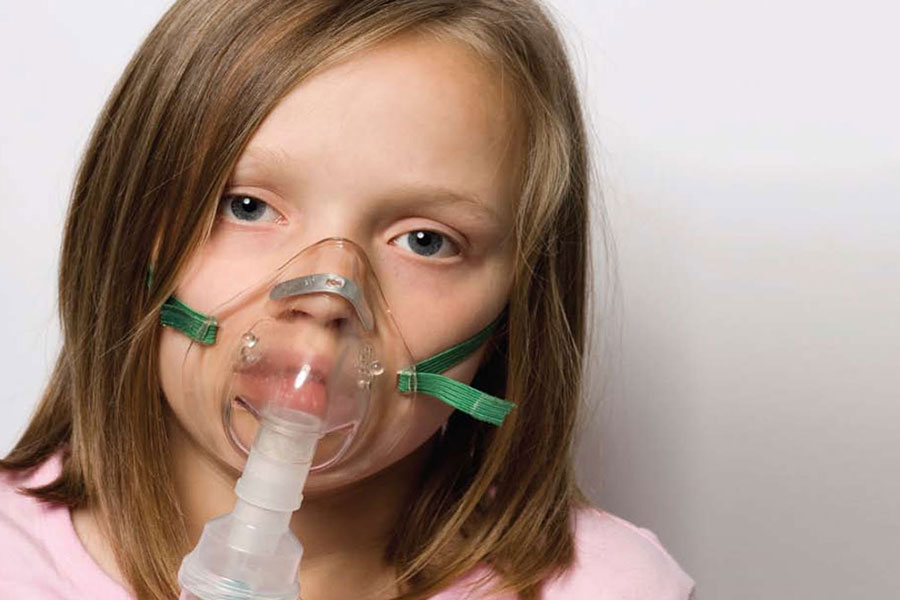 Girl wearing oxygen mask