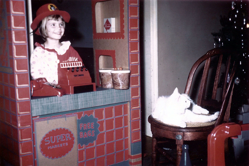 AT Direct founder Judy Antisdel as a child with a toy cash register