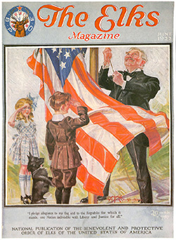 The Elks Magazine cover, June 1922, shows a man and two children raising a USA flag