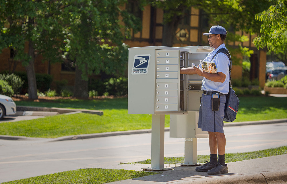 A wall mounted mailbox with mail chute