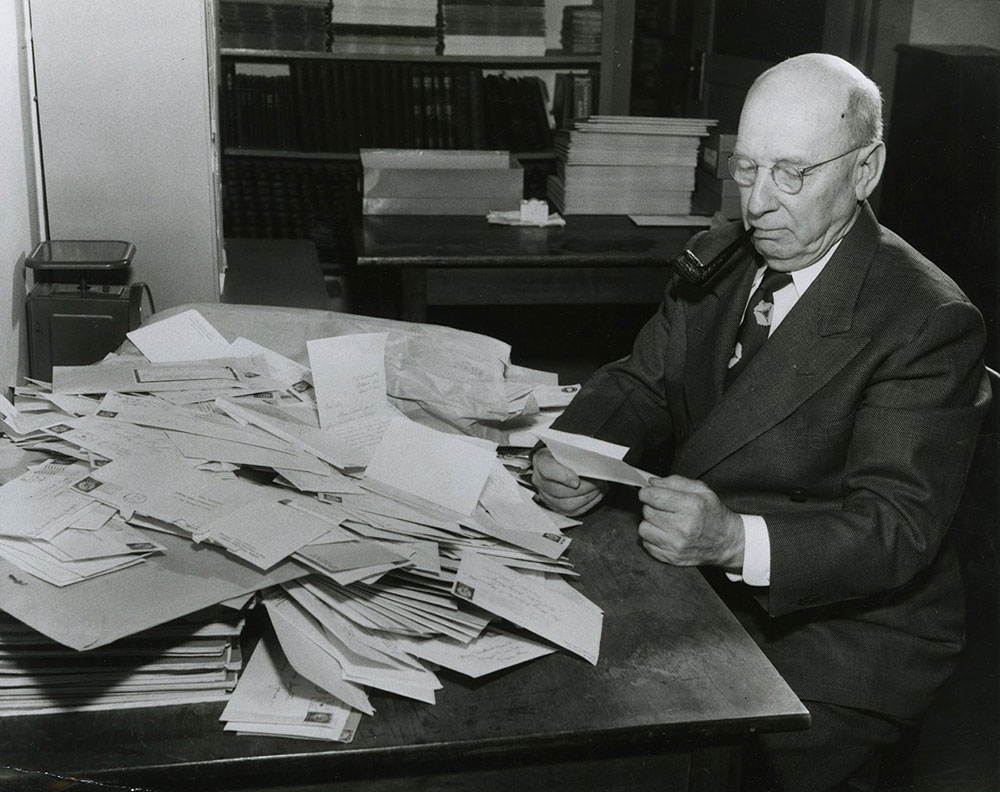 Garry Cleveland Myers, founder and editor, reading mail from children in the early 1950s.
