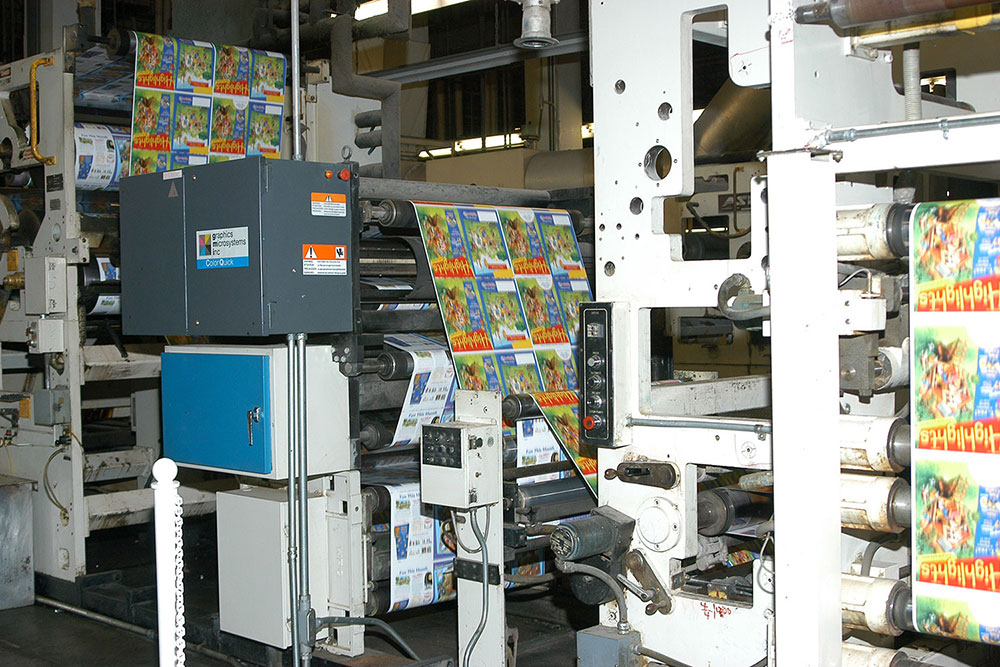 Highlights magazines are trimmed and then moved onto a conveyor that flips them into the proper position for mailing labels.