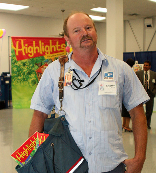 Timothy Teamann, a 26-year veteran of the United States Postal Service, delivers the one-billionth copy of Highlights magazine.