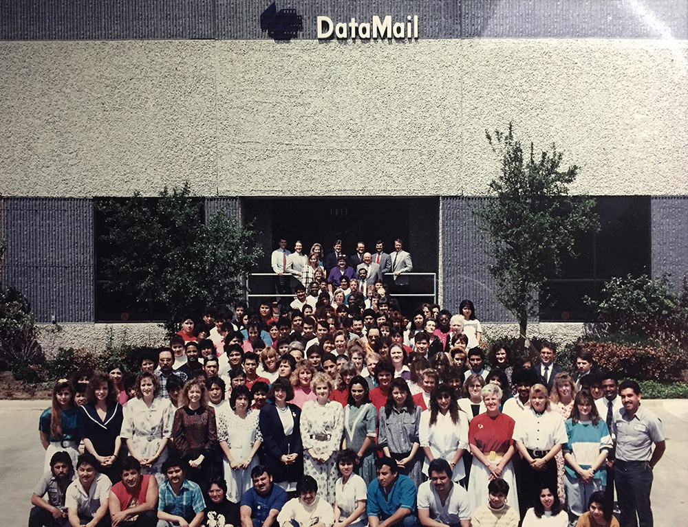 1990's Employees in front of the Lee DataMail building.