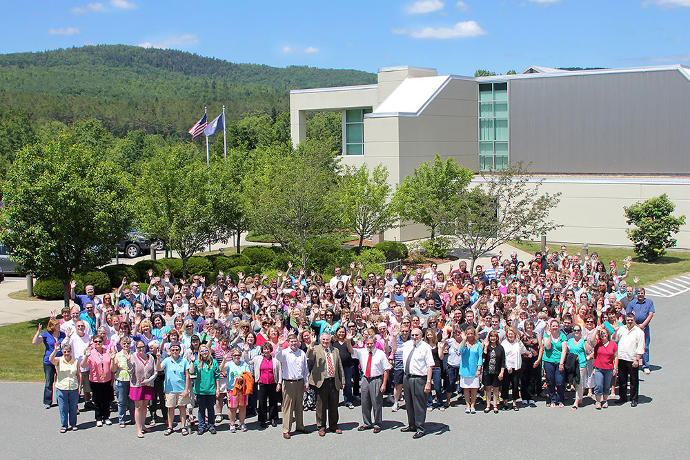 Over 320 Littleton Coin Company employees standing in front of the New Hampshire headquarters.