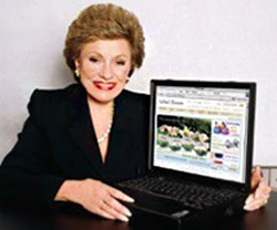 Lillian Vernon holding her computer