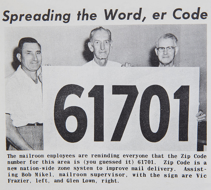 State Farm staff holding a large ZIP Code sign