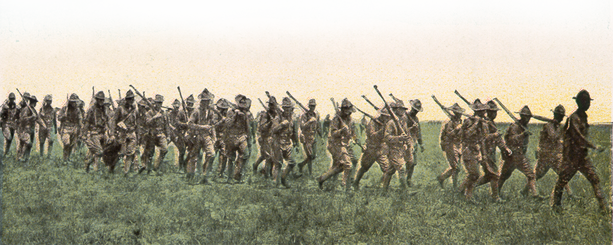 soldiers carrying guns in a field