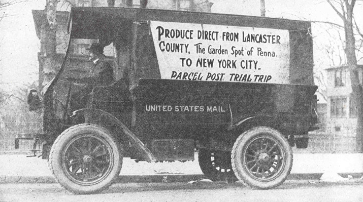 An early Rural Free Delivery truck with the sign 'Produce Direct from Lancaster County, The Garden Spot of Penna. to New York City, Parcel Post Trial Trip'