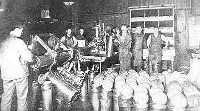 photo of men working at a pneumatic tube station