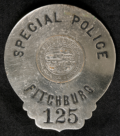 Badge used by a criminal to impersonate a police officer