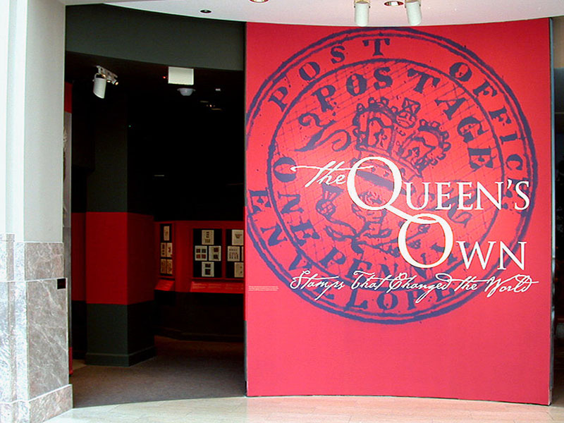Gallery entrance graphic with photos of Queen Elizabeth II and King George V