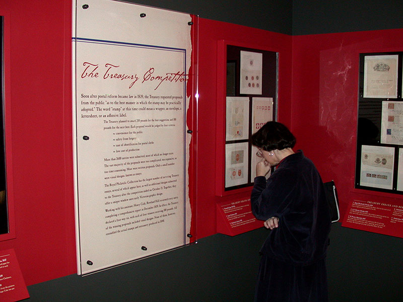 A visitor reading a panel in the exhibition
