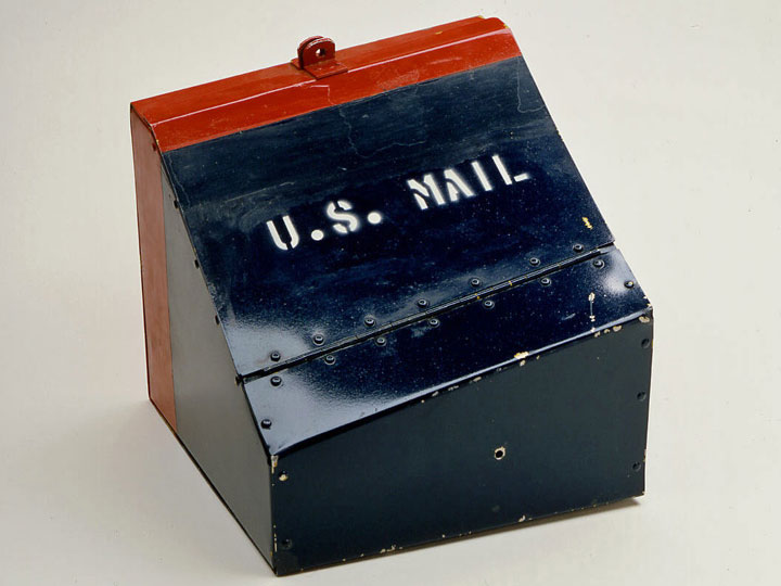 One of the two blue and red U.S. Mail Regulus I mail containers