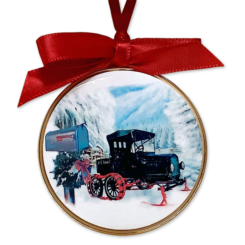 Hoilday tree ornament with a photo of a Snowbirt mail truck and a mailbox in a snowy landscape