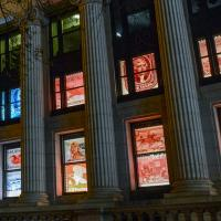 Front windows showing stamp images at night