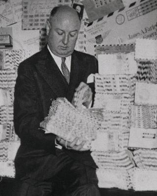 James A. Farley surrounded by stacks of mail