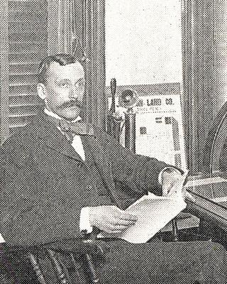 Benjamin K. Miller sitting at a desk