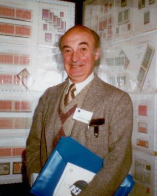 Raymond Gaillaguet posing with a stamp display