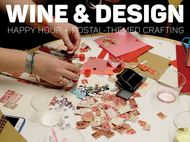 A table filled with stamps, craft materials, and an empty wine cup.